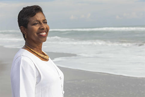 An African American woman standing on a beach